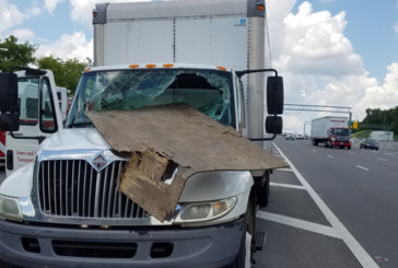 Driver Injured by Flying Plywood on I-65 South